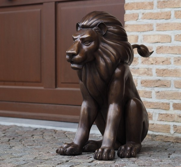 Sitzender Löwe Leon Bronzefigur